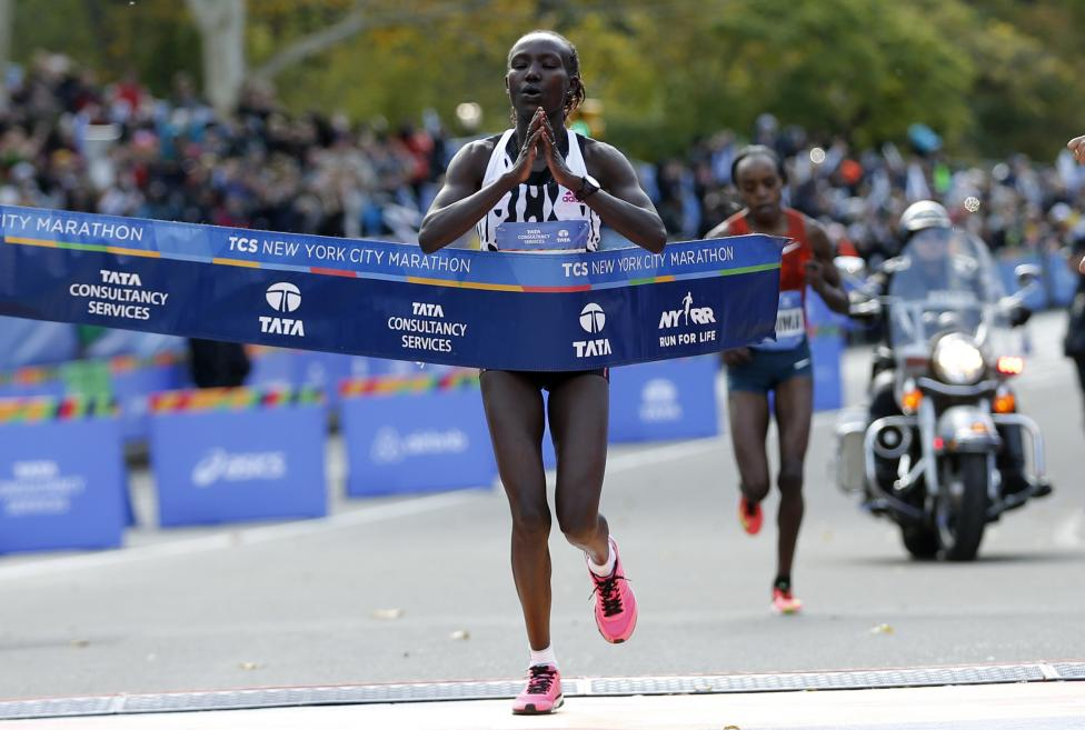 Keitany of Kenya crosses the finish line to win the women's professional division of the 2014 New York City Marathon in Central Park in Manhattan