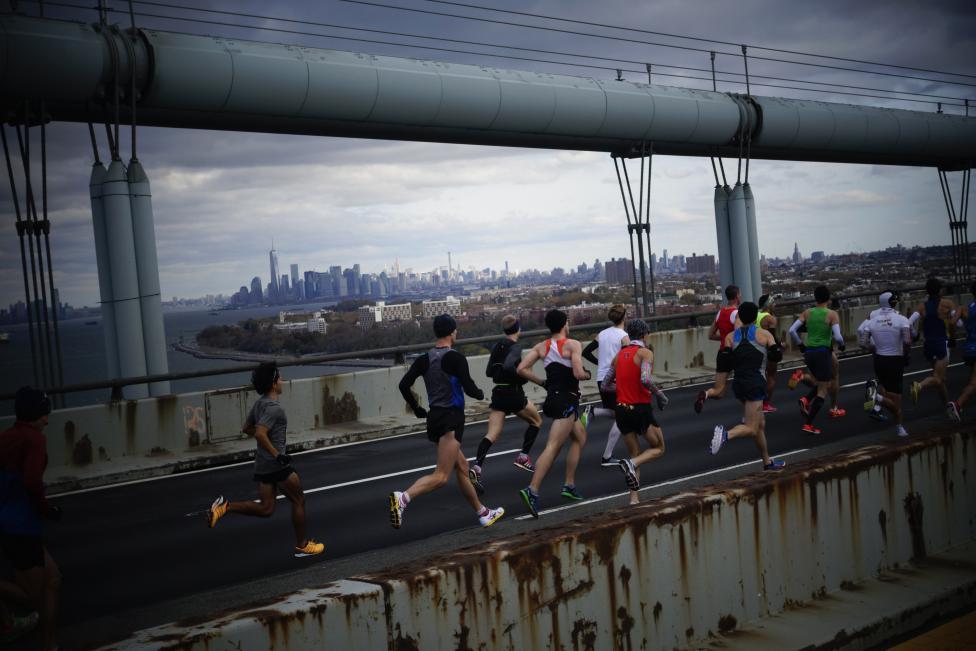 Runners make their way across the Verrazano-Narrows Bridge during the New York City Marathon in New York